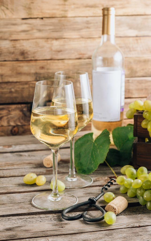 Two glasses and bottle of white wine to pair with chicken shawarma