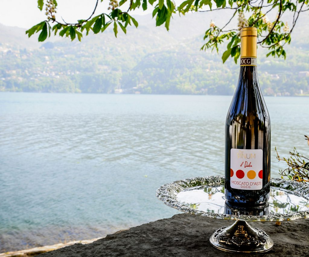 Bottle of Moscato d'Asti by a river or sea bank